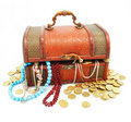 Old wooden trunk with money and jewellery isolated Royalty Free Stock Photo