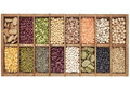 Old wooden typesetter box samples assorted legumes green red french lentils soybean green yellow pea fava bean kidney black mung Stock Photos