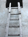 Old wooden vintage cuve ladder near a wall concept Stock Photos