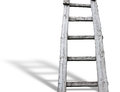 Old wooden vintage cuve ladder with shadow over white background Stock Photography