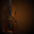 Old wooden violin on dark brown Royalty Free Stock Photo