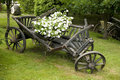 Old wooden wagon filled with flowers Royalty Free Stock Photography