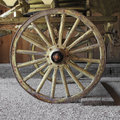 Old wooden wagon wheel on a wagon Royalty Free Stock Photo