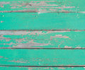 An old wooden wall of boards with peeling paint. Beautiful background.