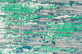 Old wooden wall with cracked and peeling green paint Royalty Free Stock Photo