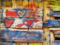 Old wooden wall love grafitti Royalty Free Stock Photo