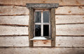 Old wooden wall with small window Royalty Free Stock Photo
