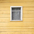 Old wooden wall with a window and the curtains Royalty Free Stock Photos