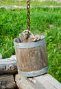 Old wooden water bucket on the wooden well Royalty Free Stock Photo