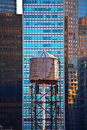 Old wooden water tower downtown in new york Royalty Free Stock Photography