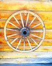 Old Wooden Wheel On wooden wall Royalty Free Stock Photo