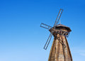 Old wooden windmill against the blue sky Royalty Free Stock Image
