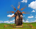 Old wooden windmill on the background of blue sky Royalty Free Stock Photography