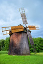 Old wooden windmill in a cloudy day Royalty Free Stock Photography