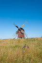 Old wooden windmill in sweden red painted on the island oland the mill is of post mill type an one of the more than well Royalty Free Stock Photo
