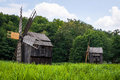 Old wooden windmills near a forest still working they re location is right Stock Photos