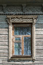 Old wooden window with carved architraves unpainted tutaev russia Royalty Free Stock Images