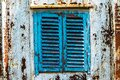 Old wooden window painted blue with rusty lock. Texture, wall of an old wooden house with shuttered windows, painted blue. Royalty Free Stock Photo
