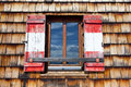 Old wooden window with shutters in the national colors of austria Stock Photos