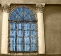 Old wooden windows with concrete walls and columns Royalty Free Stock Photos