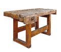 Old wooden workbench isolated and worn with vise on white Stock Photography