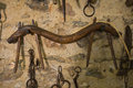 Old wooden yoke hanging on a stone wall badajoz spain Royalty Free Stock Images