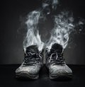 Old work shoes in smoke Royalty Free Stock Photo