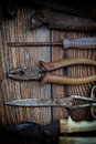 The old working tool against wooden planks Royalty Free Stock Image