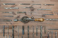 Old working tools. A hand drill with drills on Royalty Free Stock Photo