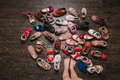Old worn baby (child, kid) shoes on the floor. baby feet (legs, Royalty Free Stock Photo