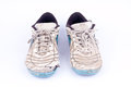 Old worn out futsal sports shoes on white background isolated Royalty Free Stock Photo