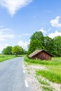 Old Worn Red Barn Near Road Royalty Free Stock Photo