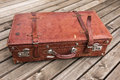 Old worn vintage brown leather suitcase Royalty Free Stock Photo