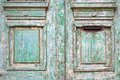 Old worn wooded door with green paint peeling off Royalty Free Stock Photo