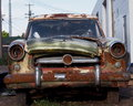 Old wrecked car with bullet holes in windshield Stock Photo