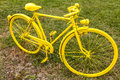 Old yellow bicycle in a field vintage green Stock Image