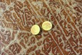 old yellow buttons on brown desk Royalty Free Stock Photo