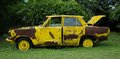 Old yellow car with hole and rust cover Royalty Free Stock Photos
