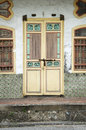 Old yellow heritage door, Penang, Malaysia Royalty Free Stock Photo