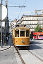 Old yellow porto tramway middle city traffic morning september Royalty Free Stock Image