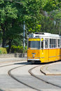 An old yellow tram in the historic city centre of budapest hungary Stock Images