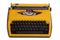 Old yellow typewriter on white Stock Photography