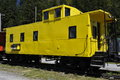 Old yellow wagon usa traditional railway on a holding siding Stock Image