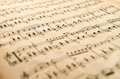 Old yellowed aged music score low angle view of an with shallow dof Royalty Free Stock Images