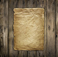 Old yellowing paper on wood Royalty Free Stock Photo
