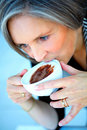 Older Businesswoman Enjoying Coffee Stock Images