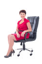 Older businesswoman sitting in office chair isolated on white background Stock Images