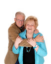Older couple hugging a lovely embracing each other the men standing behind his wife isolated for white background Royalty Free Stock Photography