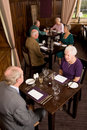 Older couples dining in restaurant Royalty Free Stock Images