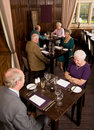 Older couples in restaurant Royalty Free Stock Image
